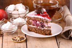 Chocolate Cake with tea cup and meringues Royalty Free Stock Images