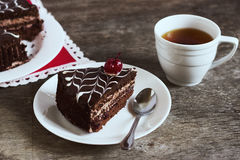 Chocolate cake with tea on dark background. Small depth of field, toned image, selective focus.  Royalty Free Stock Images