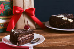 Chocolate cake with tea on gifts background. Small depth of field, toned image, selective focus.  Stock Photography