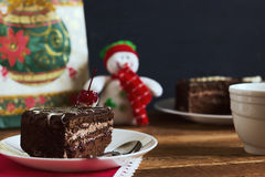 Chocolate cake with tea on gifts background. Small depth of field, toned image, selective focus Royalty Free Stock Photography