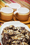 Chocolate cake and three cups, picnic theme Stock Photography