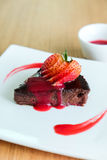 Chocolate Cake topping with sliced strawberry Royalty Free Stock Photo