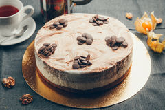 Chocolate cake. Triple layer chocolate cake over the white background stock image