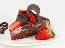 Chocolate cake and truffle. Isolated chocolate cake with strawberry on white background Royalty Free Stock Photo