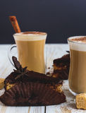 Chocolate cake, two cups of cappuccino and spices Stock Photography
