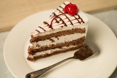 Chocolate cake with vanilla cream. On a plate Royalty Free Stock Photo
