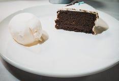 Chocolate cake with vanilla ice cream royalty free stock image