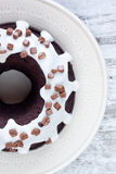 Chocolate cake with vanilla sauce Stock Photos