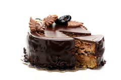 Chocolate cake with walnuts and prunes. Royalty Free Stock Photos