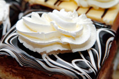 Chocolate cake and whipped cream stock images