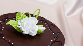 Chocolate cake with white candy rose decoration Stock Photo
