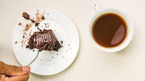 Chocolate cake in white ceramic plate on a wooden board. Stop Motion stock video