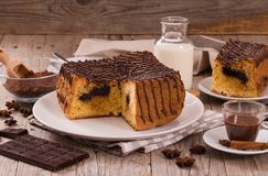 Chocolate cake. Chocolate cake on white dish royalty free stock photography