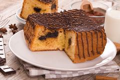 Chocolate cake. Chocolate cake on white dish royalty free stock photo