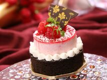 Chocolate Cake With White Icing and Strawberry on Top With Chocolate Stock Image