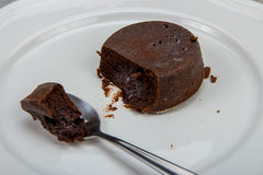 Chocolate cake on white plate clolse-up Royalty Free Stock Image