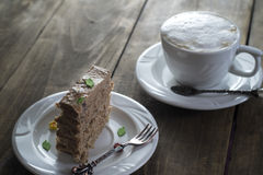 Chocolate cake on the white plate with Royalty Free Stock Photography