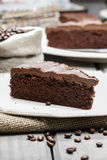Chocolate cake on white plate, on hessian Royalty Free Stock Image