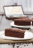 Chocolate cake on white plate, on hessian Stock Photos