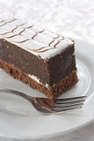 Chocolate cake with white sugar glaze Royalty Free Stock Images
