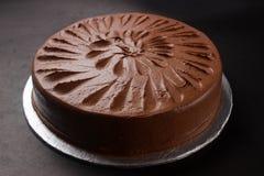 Chocolate Cake. Whole dark chocolate birthday cake Stock Photo