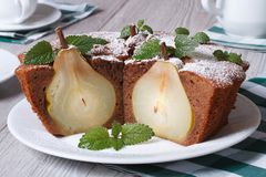 Chocolate cake with whole pears and mint closeup horizontal Stock Photography