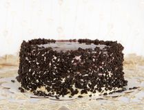 Chocolate Cake With Chocolate, Cake Isolated On Warm Light Background With Selective Focus And Uneven Light. Concept.Birthday Cake Stock Image
