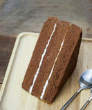 Chocolate cake. On wood background Royalty Free Stock Photography