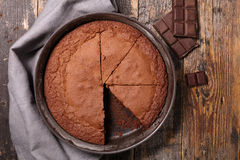 Chocolate cake. On wood background royalty free stock images