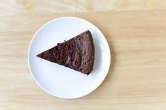 Chocolate cake on wood table. Stock Image