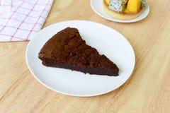 Chocolate cake on wood table. Stock Photo