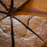 Chocolate cake. On the wooden cupboard Stock Images