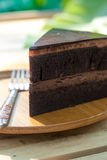 Chocolate Cake on wooden plate royalty free stock photo