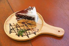 chocolate cake on wooden plate for pattern Royalty Free Stock Photo