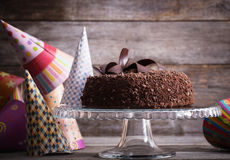 Chocolate cake on wooden table stock photography