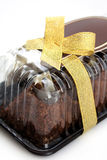 Chocolate cake wrapped in gift Royalty Free Stock Photo