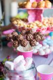 Chocolate cakepops and popcorn on dessert table at Royalty Free Stock Photography