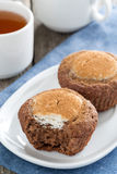 Chocolate cakes with cheese filling and cup of tea Stock Photography