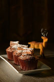 Chocolate Cakes For Christmas. Chocolate cupcakes with reindeer decoration for Christmas stock images