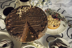 Chocolate cakes and Coffee table Royalty Free Stock Images