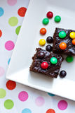 Chocolate cakes with color dragee Royalty Free Stock Image