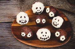 Chocolate cakes in the form of monsters and skeletons for kids Stock Photos