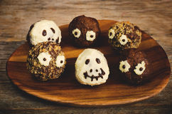 Chocolate cakes in the form of monsters and skeletons for kids Stock Photo