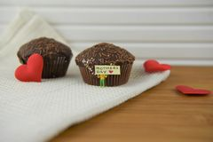 Chocolate cakes with love heart decorations and mothers day words Stock Photos
