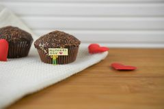 Chocolate cakes with love heart decorations and mothers day words Stock Photo