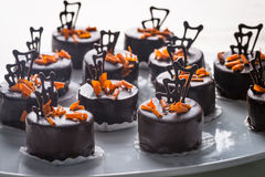 Chocolate cakes and orange Royalty Free Stock Photos