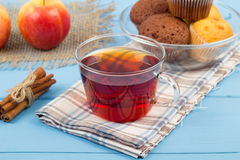 Chocolate cakes, tea and apples Royalty Free Stock Photos