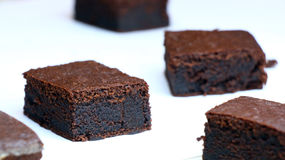 Chocolate cakes: very black chocolate brownies on a white plate Stock Images