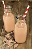 Chocolate caliente en botellas en la madera Foto de archivo libre de regalías