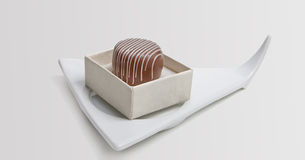 Chocolate candie. In a white box on the white dish Stock Photos